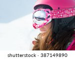 Female Skier With Skis Smiling...