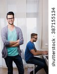 happy gay couple working... | Shutterstock . vector #387155134