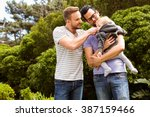 smiling gay couple with child... | Shutterstock . vector #387159466