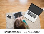 woman lying on the floor while...   Shutterstock . vector #387188080