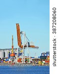 port cargo crane and container... | Shutterstock . vector #387208060