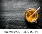 jar of natural honey . on the... | Shutterstock . vector #387215044