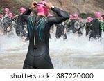 triathletes group splash of... | Shutterstock . vector #387220000