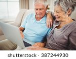 senior couple sitting on sofa...   Shutterstock . vector #387244930