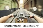 man driving on scooter at old... | Shutterstock . vector #387258979