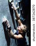 portrait of fit woman rock... | Shutterstock . vector #387262870