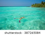 woman snorkeling in clear... | Shutterstock . vector #387265084