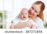 happy family mother hugging her ... | Shutterstock . vector #387271858