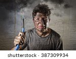young man holding electrical... | Shutterstock . vector #387309934