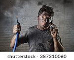 Young Man Holding Electrical...