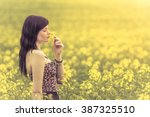 Genuine Woman In Meadow Of...