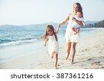 family walking on the evening... | Shutterstock . vector #387361216
