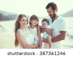 family walking on the evening... | Shutterstock . vector #387361246