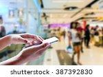 girl use mobile phone  blur... | Shutterstock . vector #387392830