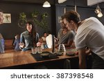 woman and colleagues at modern...   Shutterstock . vector #387398548