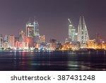 manama city skyline illuminated ...   Shutterstock . vector #387431248