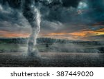 Black Tornado Funnel Over Fiel...