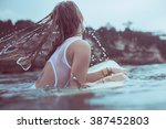 Girl In A White Bathing Suit I...