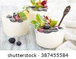 fresh yogurt with berries. on... | Shutterstock . vector #387455584