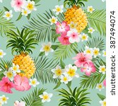 tropical flowers and pineapples ... | Shutterstock .eps vector #387494074