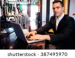 businessman using laptop at the ... | Shutterstock . vector #387495970