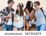 hip couples talking against... | Shutterstock . vector #387502879