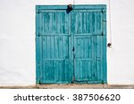 old house with doors and... | Shutterstock . vector #387506620