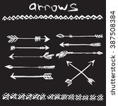hand drawn ink set of arrows... | Shutterstock .eps vector #387508384
