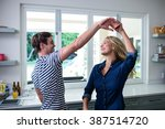 cute couple dancing in the... | Shutterstock . vector #387514720