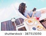 young woman relaxing on a sun... | Shutterstock . vector #387515050