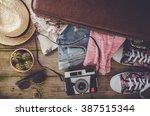 travel preparations on wooden... | Shutterstock . vector #387515344