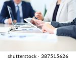 business adviser analyzing... | Shutterstock . vector #387515626