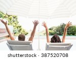 young couple near swimming pool ...   Shutterstock . vector #387520708