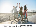 friends on bike doing high five ... | Shutterstock . vector #387528778