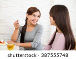 woman talk to each other at... | Shutterstock . vector #387555748