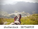 legs of traveler sitting on a... | Shutterstock . vector #387568939