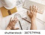 image of engineer hands working ... | Shutterstock . vector #387579946