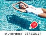 Girl Floating On Beach Mattres...