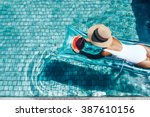 girl floating on beach mattress ... | Shutterstock . vector #387610156