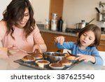 mother and daughter making... | Shutterstock . vector #387625540