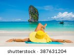 beautiful woman on the beach.... | Shutterstock . vector #387631204