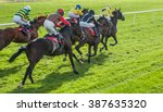 Stock photo race horses sprinting words the finish line 387635320