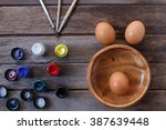 eggs and color on wood... | Shutterstock . vector #387639448