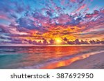 colorful sunset over ocean on...