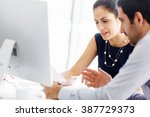 Stock photo business people in modern office 387729373