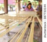 silk weaving | Shutterstock . vector #387733144