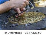 two hands of craftsman... | Shutterstock . vector #387733150