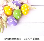 colorful easter eggs on white... | Shutterstock . vector #387741586