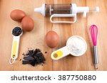 baking utensils on wooden table. | Shutterstock . vector #387750880