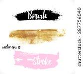 brushstroke of gold paint  | Shutterstock .eps vector #387756040